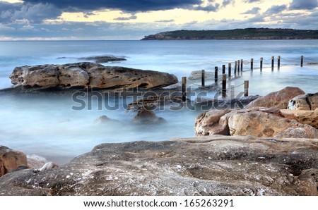 Idyllic Mahon rock pool, Maroubra, near Sydney Australia at early dawn, that is filled by surging tidal swells from the Tasman Sea - stock photo