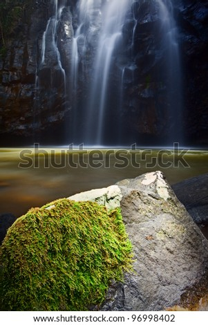 idyllic paradise waterfall with green moss growing on the rocks tranquil natural purity smooth blurred surface