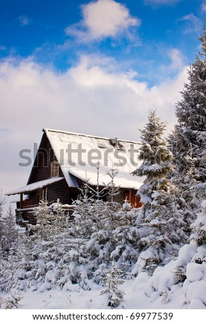 Idyllic photo of a mountain house during the winter. - stock photo