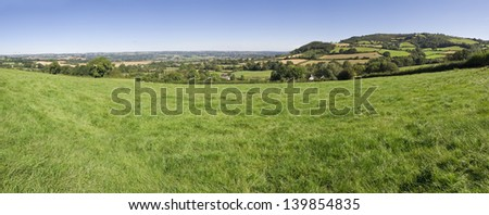 Idyllic rural view of pretty farmland in the beautiful surroundings of the Cotswolds, England, UK. - stock photo