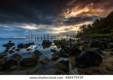 Idyllic scene of rocks on the shoreline at sunset/sunrise in Kauai, Hawaii