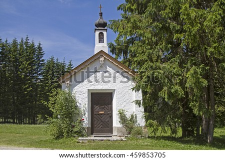 Idyllic small chapel in Ursprungs valley south of Bayrischzell - stock photo