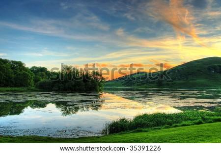 Idyllic summer scenery at sunset - stock photo