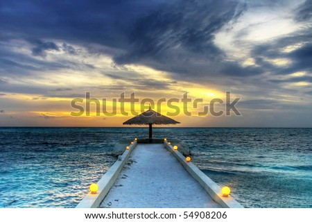 Idyllic sunset over indian ocean - Maldives - stock photo