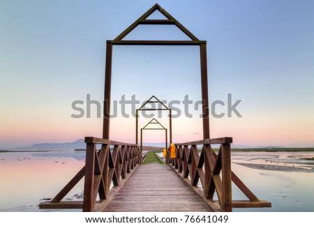 Idyllic sunset over the bridge - stock photo