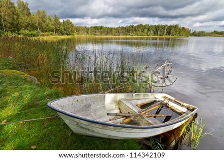 Idyllic Swedish lake in summer time - stock photo