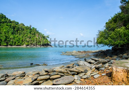 Idyllic tropical beach and rock at Thailand. . - stock photo