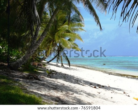 Idyllic tropical beach on Rarotonga, Cook Islands - stock photo