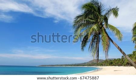 Idyllic tropical beach resort - stock photo