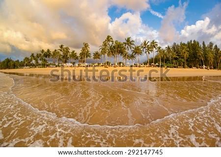 Idyllic tropical beach resort sunset - stock photo