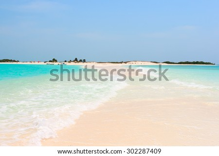 Idyllic tropical beach with perfect turquoise water - stock photo