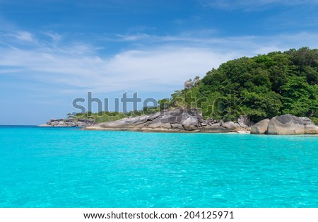 Idyllic tropical blue sea and stone shore of Similan Islands with transparent  turquoise water, Ko Miang, National Park  - stock photo