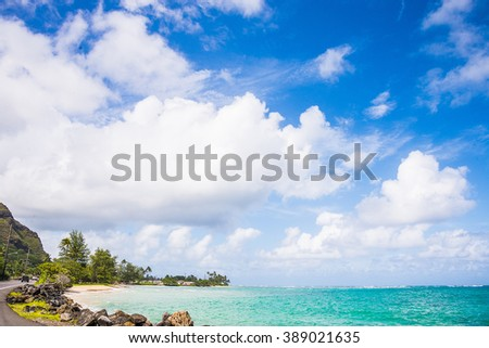 Idyllic tropical Darkwood beach at Antigua island in Caribbean with white sand, turquoise ocean water and blue sky - stock photo