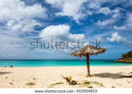 Idyllic tropical Ffryes beach with white sand, turquoise ocean water and blue sky at Antigua island in Caribbean - stock photo