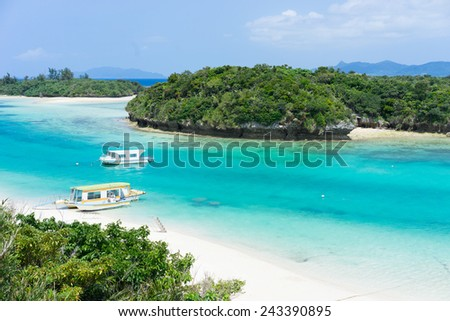 Idyllic tropical lagoon with bright turquoise water and white sand surrounded by lush green islands in Okinawa, Japan - stock photo