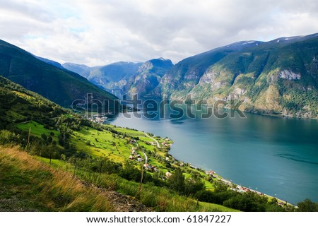 Idyllic view fjord, village and mountains of Norway - stock photo