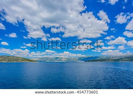 Idyllic waterfront view at Adriatic sea and Croatian coast during summertime, Croatia. / Summer seascape coast Dalmatia. - stock photo
