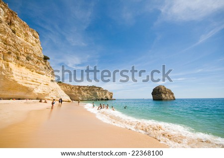 Idyllic wild beach in summertime. Algarve, Portugal. - stock photo