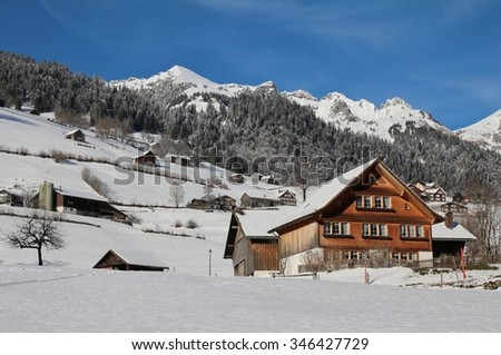 Idyllic winter scene in the Toggenburg valley - stock photo