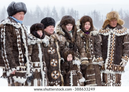 Iengra, Neryungri District, Yakutia, Russia. March 5, 2016 Evenk family in national costumes at the celebration of the Reindeer - stock photo