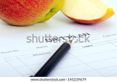iet plan, apples and pen - stock photo