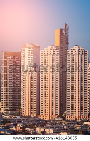 iew of modern office buildings, condominium high rise and low rise in big city downtown with sunset sky - stock photo