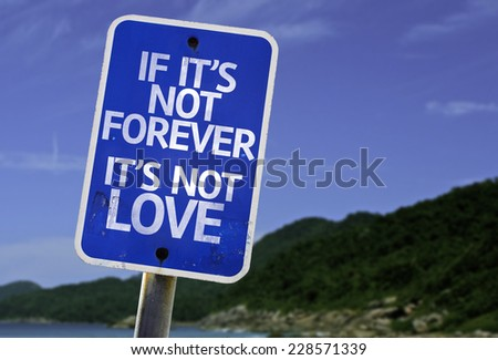 If It's Not Forever It's Not Love sign with a beach on background - stock photo