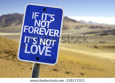 If It's Not Forever It's Not Love sign with a desert background - stock photo