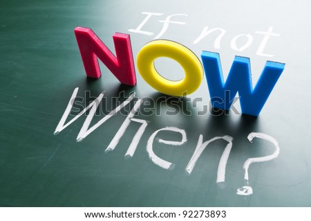 If not now, when? Colorful words on blackboard. - stock photo
