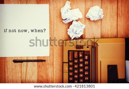 If not now, when? message on a white background against view of an old typewriter and paper - stock photo