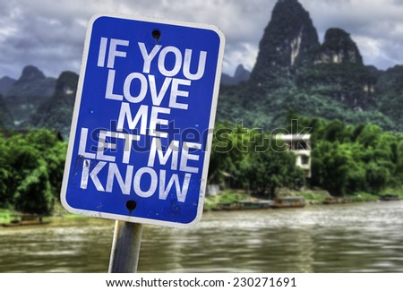 If You Love Me Let me Know sign with a forest background - stock photo