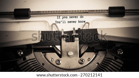 If You Never Do You'll Never Know concept on typewriter  - stock photo