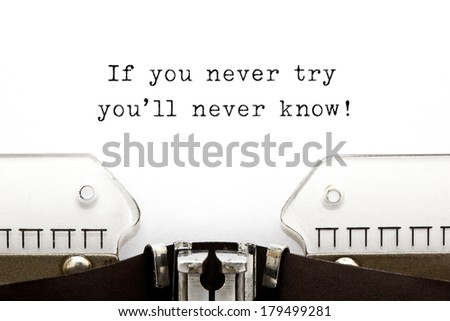 If you never try you'll never know! printed on an old typewriter. - stock photo
