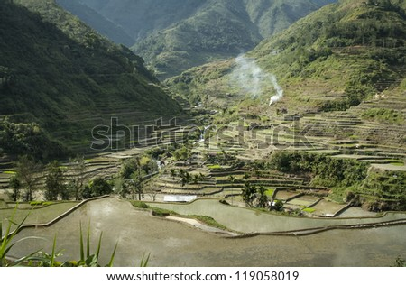 ifugao rice terraces cut into the steep mountain sides of banaue province in northern luzon in the philippines - stock photo