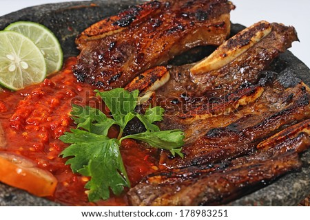 iga penyet pedas, spicy grilled ribs on mortar, Indonesian cuisine