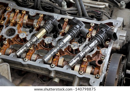 Ignition coil on car gasoline engine with two camshafts - stock photo