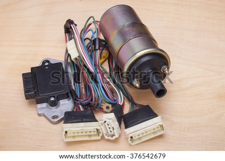 ignition coil; switch and wires on the vehicle ignition system - stock photo