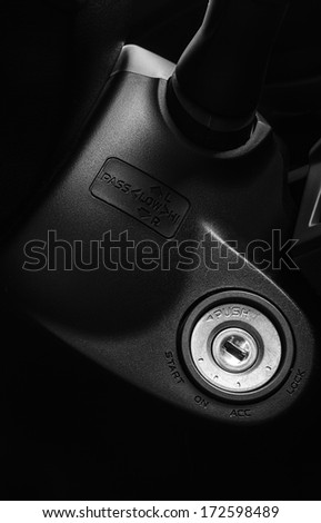 ignition key in new car interiors,start the car - stock photo