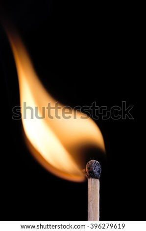 Ignition of a match, on dark background.