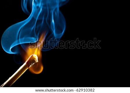 Ignition of match with smoke, isolated on black background - stock photo
