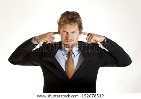 Ignorant businessman covering his ears - stock photo