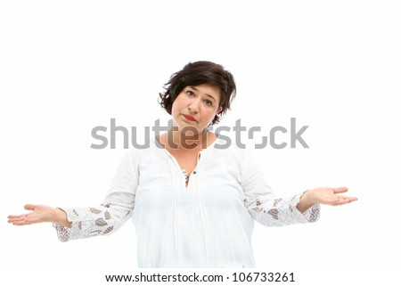 Ignorant woman shrugging her shoulders and extending her arms to indicate she has no clue or a possible conceptual image for product placement in her empty palms - stock photo