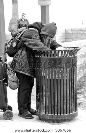 Ignore Her ... Maybe She Won't Really Be There - The grim reality of the homeless epidemic ... if we don't look, we don't have to see. - stock photo