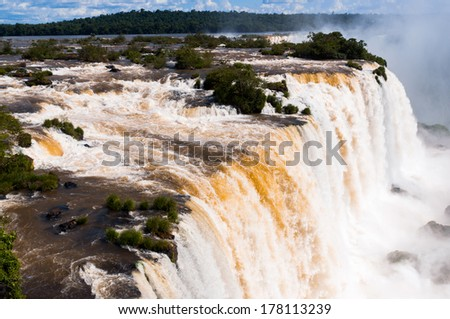 Iguassu Falls is the largest series of waterfalls on the planet, located in Brazil, Argentina, and Paraguay. - stock photo