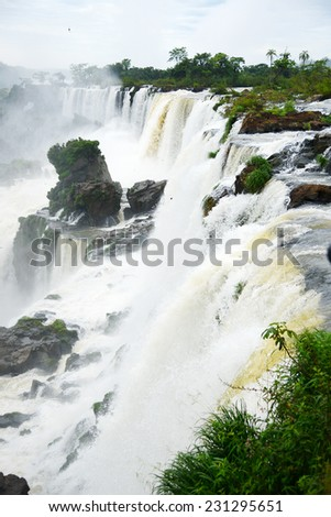 Iguassu waterfall in south america tropical jungle with a massive flow of water