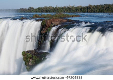Iguazu Falls located on the border of Brazil and Argentina - stock photo