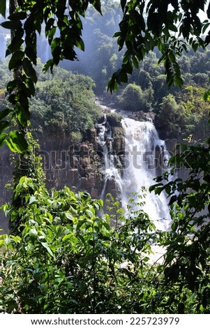Iguazu Falls - spectacular waterfalls on Brazil and Argentina border. National park and UNESCO World Heritage Site. Seen from Brazilian side. - stock photo