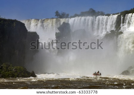 Iguazu waterfalls and the boat - stock photo