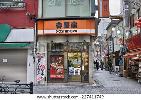 IKEBUKURO, TOKYO - AUGUST 28, 2014: Yoshinoya Gyudon (Beef bowl) restaurant in Ikebukuro, Tokyo. Second largest Gyudon chain in Japan. Beloved by Japanese locals and called abbreviated as Yoshigyu. - stock photo