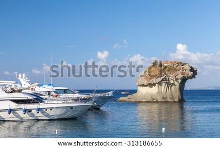 Il Fungo. Mushroom shaped rock in bay of Lacco Ameno, Ischia island, Italy - stock photo